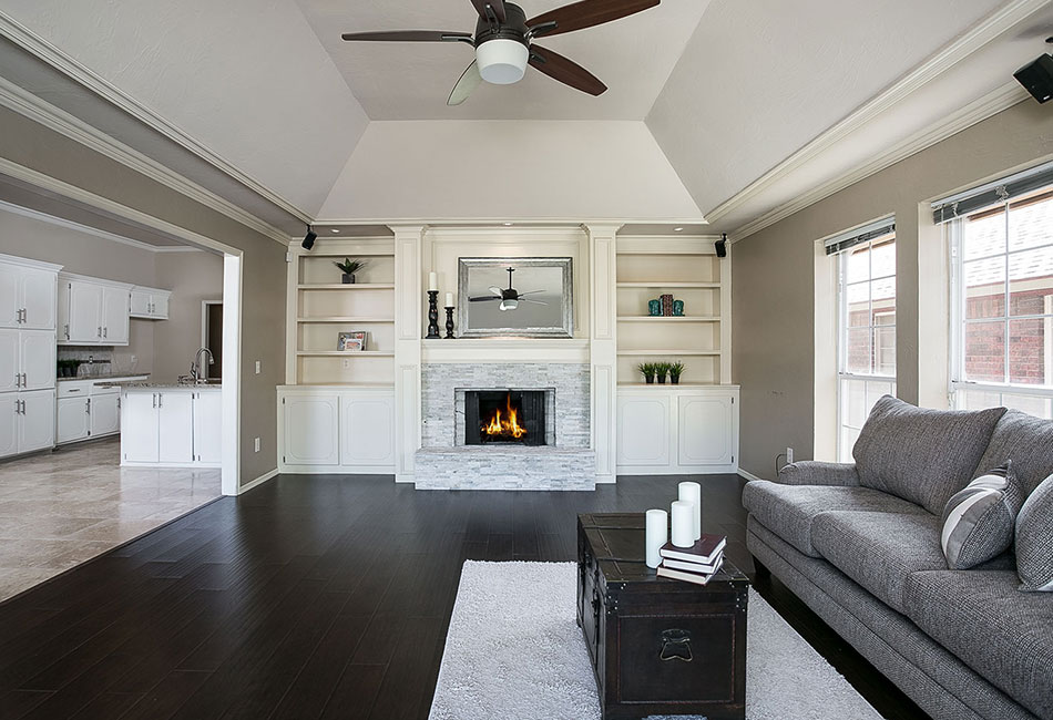 Staged living room with fireplace.