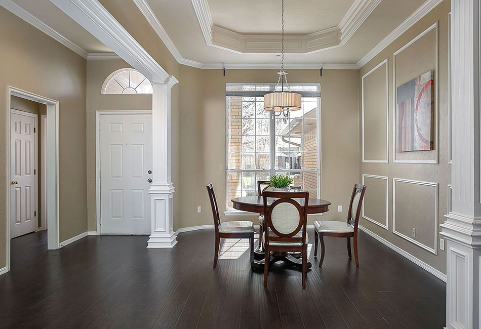 Staged formal dining room.