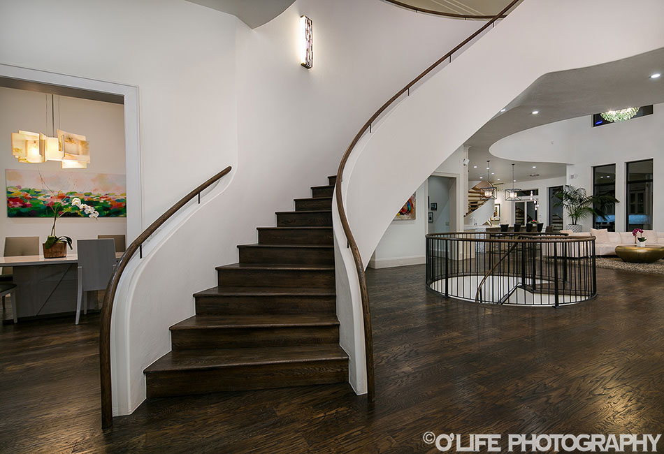 Stairs and Living Room In Gallardia Luxury Home