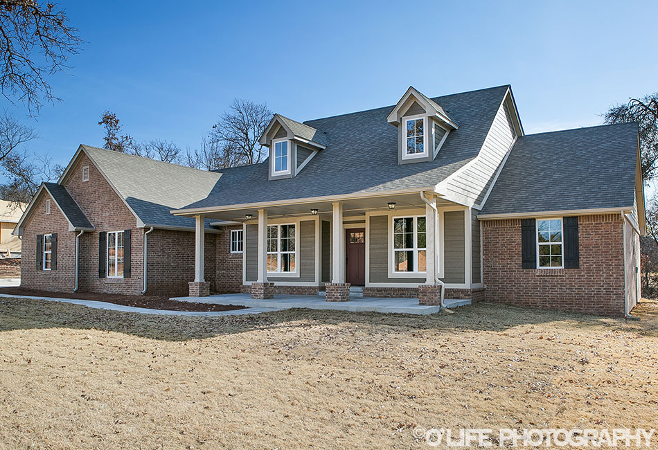 New Home Elevation in Guthrie by OLife Photography