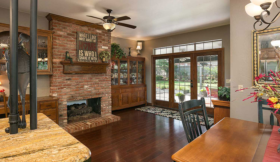 FSBO kitchen with fireplace and patio.
