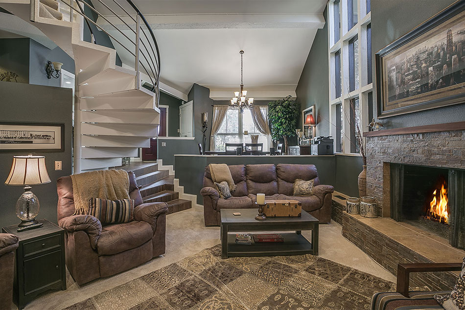 Quail Creek living room with fireplace.