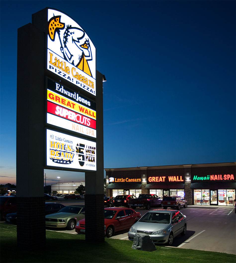 Strip Mall With Sign In Front